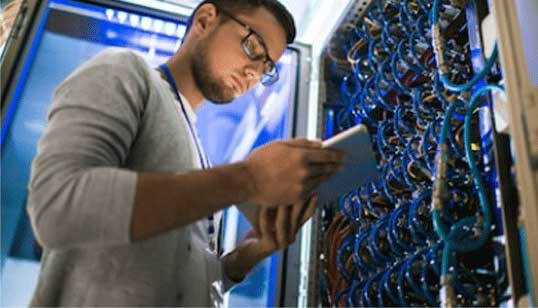 Picture of Young White Male checking/testing Network circuits